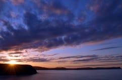 Kust zonsondergang Stock Foto's