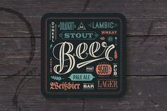 Kustfartyg för öl med hand dragen bokstäver stock illustrationer