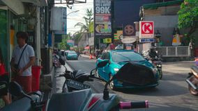 Traffic on narrow street in Kuta, Bali. stock video