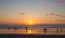 Kuta beach. People enjoying sunset on Kuta beach in Bali, Indonesia Royalty Free Stock Photography