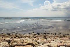 Kuta Beach palm coat, luxury resort with swimming pool and sunbeds. Bali, Indonesia. Stock Photos