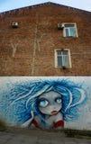Kutaisi Street Art på husväggen arkivbild