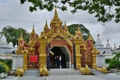 South entrance gate. Kuthodaw pagoda. Mandalay region. Myanmar royalty free stock photography