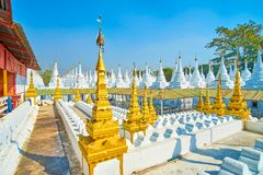 The old religion complex with restores stupas, Mandalay, Myanmar. The Kuthodaw Pagoda complex is one of the most honoured religion complexes of the city due to royalty free stock image