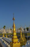 Kuthodaw Pagoda - golden spire. Unusual pagoda in the north of Mandalay, Burma Royalty Free Stock Images