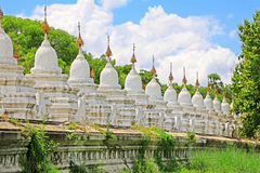 Kuthodaw Pagoda, Mandalay, Myanmar. Kuthodaw Pagoda is a Buddhist stupa, located in Mandalay, Myanmar, that contains the world`s largest book. It lies at the stock photography