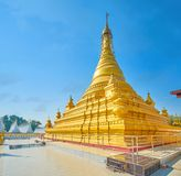 The golden Kuthodaw Pagoda in Mandalay, Myanmar. The Kuthodaw Pagoda is a masterpiece of Burmese religion architecture, located in Mandalay city, Myanmar stock photos