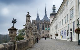 Kutna Hora, Bohemia / Czech Republic - November 2017: Passage to Church of Saint Barbara and Statues in front of Jesuit College royalty free stock images