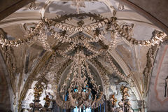 Kutna Hora, Czech Republic - March 19, 2017: Interior of the Sedlec ossuary Kostnice decorated with skulls and bones Royalty Free Stock Images
