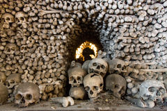 Kutna Hora, Czech Republic - March 19, 2017: Interior of the Sedlec ossuary Kostnice decorated with skulls and bones Royalty Free Stock Photography
