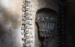 Kutna Hora, Czech Republic - March 19, 2017: Interior of the Sedlec ossuary Kostnice decorated with skulls and bones Stock Photos