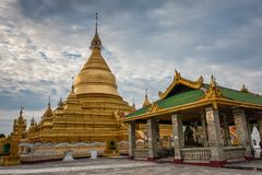 The Kutodaw Pagoda, Mandalay, Myanmar. Kuthodaw Pagoda is a Buddhist stupa, located in Mandalay, Burma, that contains the world`s largest book. It lies at the stock images
