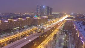 Kutuzovskiy prospect avenue Triumphal Arch holiday decoration. Night lights illumination. Moscow Russia cowered in snow and ice. Aerial drone flight. High stock video
