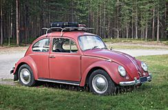 Free KUUSAMO, FINLAND - AUGUST 15, 2017: Old Red Car Volkswagen Beetle With A Black Suitcase On The Trunk Stock Image - 114496161
