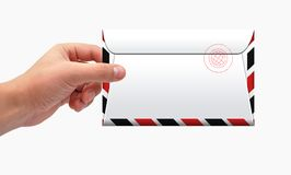 Kuvertet räcker in arkivfoton