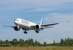 Kuwait Airways Boeing 777-300ER landing. Kuwait Airways latest and newest Boeing 777-300ER long haul airplane lands in Everett after a test flight with Seattle`s Stock Image