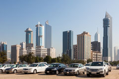 Kuwait City. Cars in front of Kuwait City skyscrapers. Middle East, Arabia stock photography