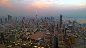 Kuwait City Lights Just Before Sunset Royalty Free Stock Photos