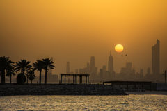 Kuwait city sunset in dusty weather Royalty Free Stock Images