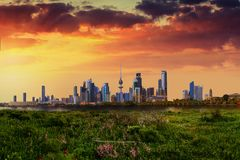 Kuwait city view during sunset. Beautiful kuwait city landscape during sunset with amazing green garden infront of it royalty free stock image