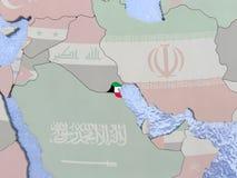 Kuwait with flag on globe Royalty Free Stock Photo