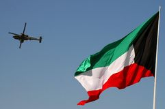 Kuwait flage with apatchi. APACHE HELICOPTER with KUWAIT flag Royalty Free Stock Image