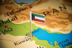 Kuwait marked with a flag on the map.  royalty free stock photos