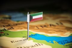 Kuwait marked with a flag on the map.  royalty free stock images
