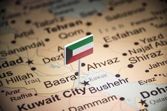 Kuwait marked with a flag on the map.  royalty free stock photo