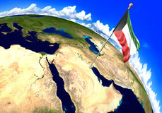 Kuwait national flag marking the country location on world map. 3D rendering, parts of this image furnished by NASA Royalty Free Stock Image