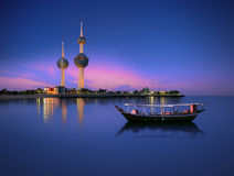 Kuwait tower. Arabian passenger boat during blue hour next to kuwait tower Royalty Free Stock Images
