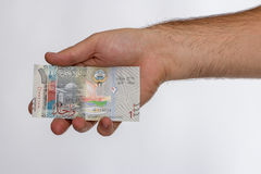 Kuwaiti dinar banknote in hand. Stock Images