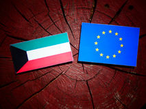 Kuwaiti flag with EU flag on a tree stump isolated Stock Photo