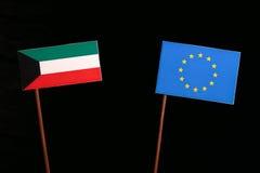 Kuwaiti flag with European Union EU flag  on black Royalty Free Stock Photography