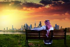 Kuwaiti man looking at kuwait city during sunset Royalty Free Stock Image