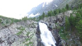 Kuyguk lake and waterfall in Altai mountains. Russian landscape aerial view stock video footage