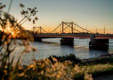 Kuznechevsky automobile beautiful bridge in Arkhangelsk at sunset across royalty free stock photos