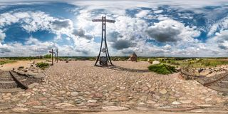 KUZNICA, POLAND - MAY 2019: Full seamless panorama 360 degrees angle view on huge memorial cross on mountain of remembrance with royalty free stock photography