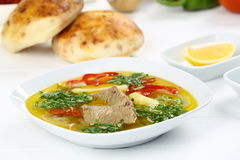 Turkish bony lamb soup with carrot. Kuzu Haslama - Lamb leg soup with carrot - Turkish Soups. Cooking beef broth with onions and carrots stock image