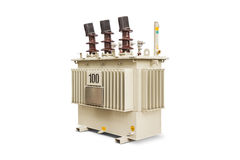 100 kVA Oil immersed transformer. Three phase (100 kVA) corrugated fin hermetically sealed type oil immersed transformer, isolated on white background with Stock Photos