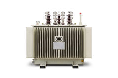 800 kVA Oil immersed transformer. Three phase (800 kVA) corrugated fin hermetically sealed type oil immersed transformer, isolated on white background with Stock Image