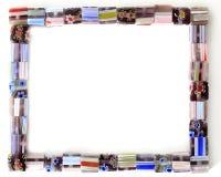 Kvadrera färgrikt pryder med pärlor inramar royaltyfri fotografi