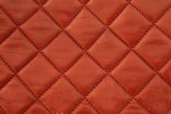 Kvadrerat rött läder Royaltyfri Bild