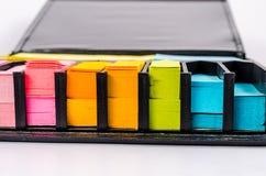 Kvarter av den flerfärgade stolpen det anmärkning Fotografering för Bildbyråer