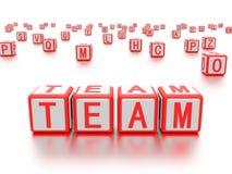 Kvarter med ordet team skriftligt på det Arkivbild