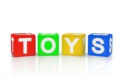 Kvarter som stavar leksaker på en vit bakgrund Arkivfoton