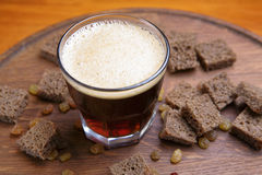 Kvass in a glass on a wooden board Royalty Free Stock Image