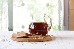 Kvass (kvas) in a transparent jug and rye bread Stock Photo