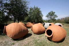 Kvevri is a jug for wine production stock image