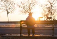 Kvinna bara på soluppgång Fotografering för Bildbyråer